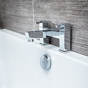 Contemporary bath with taps